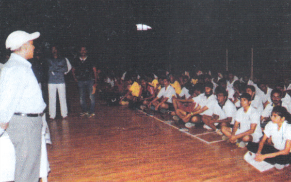 Engineer Mukesh Mulay, National Hockey Player, addressing the players at the inauguration of Inter-Collegiate Badminton Competition