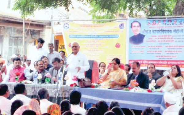 Justice Shri.B.G.Kolse Patil, Former Judge, Bombay High Court addressing villagers in the Legal Aid Camp at Pargaon Sudrik, Tal.Srigonda and Smt. Suvarna Kewale, District Judge with other dignitaries